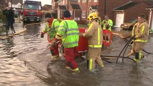 Firefighters wade through flood water in Locking (26 Nov 2012)