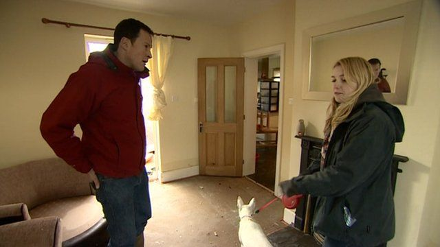 Giles Latcham and Jenny Robinson inside a flood-hit house