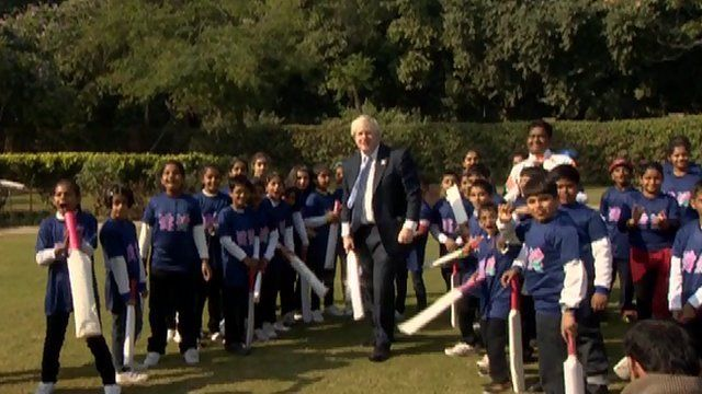 London mayor Boris Johnson playing cricket with children in India