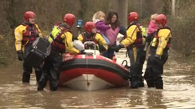 A stranded family has been rescued from their home after floodwater hit Gloucestershire