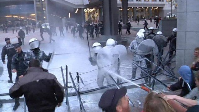 Protesters spraying riot police with milk