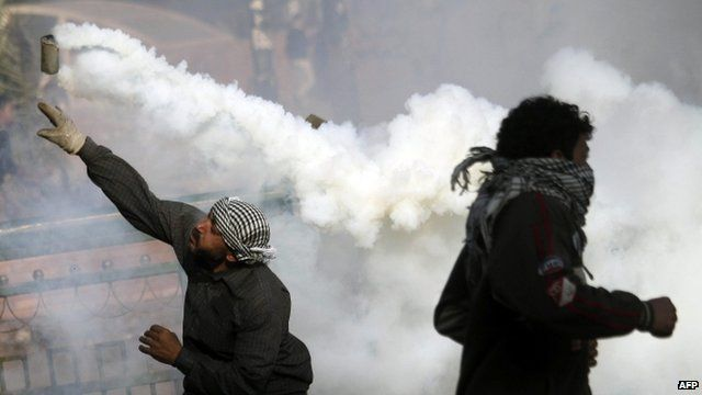 Protesters throw tear gas