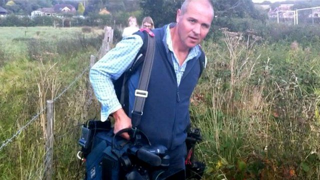 TV crew travel by foot