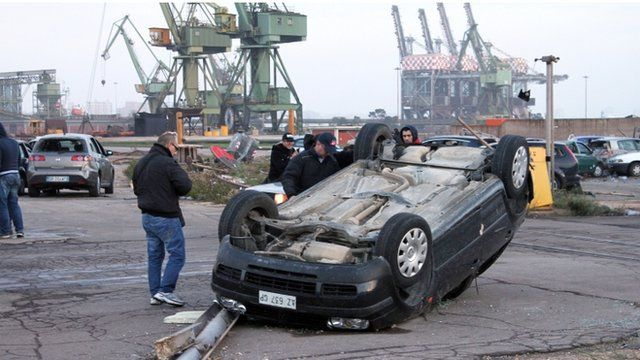 An overturned car near the Ilva steel plant in southern Italy