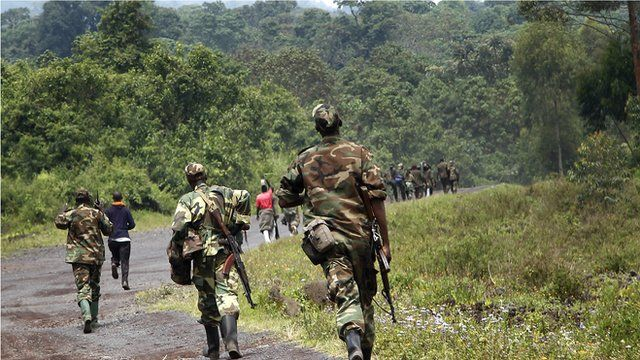 A column of Congolese M23 rebels is seen running on the Goma to Rushuru road