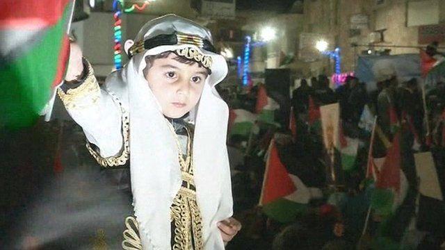 Palestinians waving flags