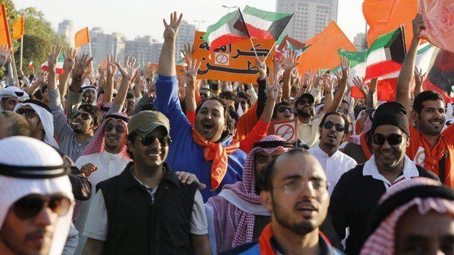 Kuwaiti opposition supporters chant slogans in Kuwait City