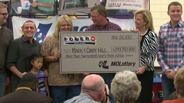 Mark and Cindy Hill holding cheque