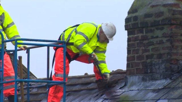 Workers begin dismantling the houses