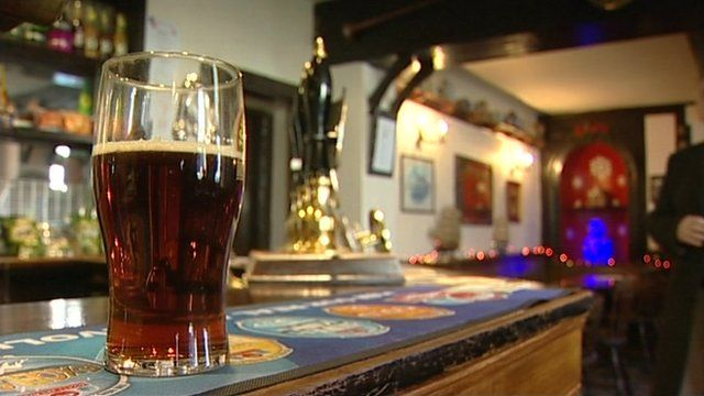 Pint of beer on pub counter