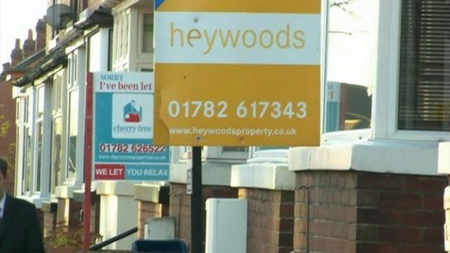Estate agents signs outside properties