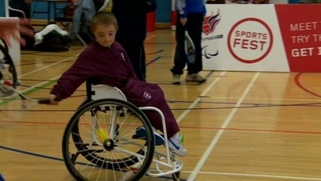 Young person tries out wheelchair tennis