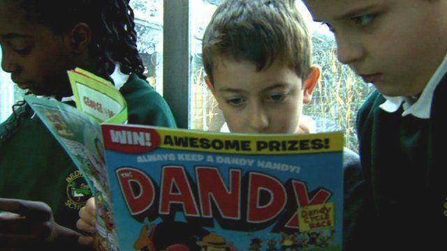Children reading Dando