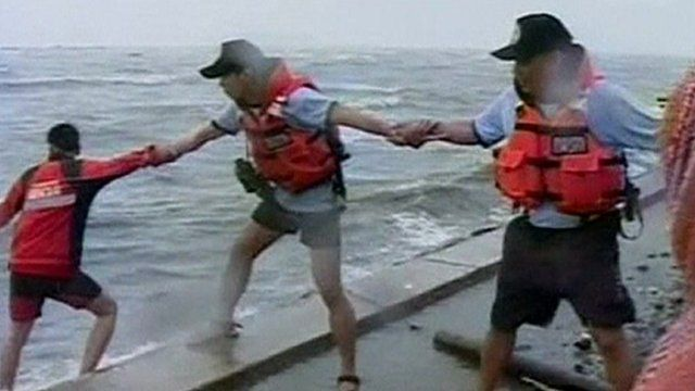 Rescue workers link arms