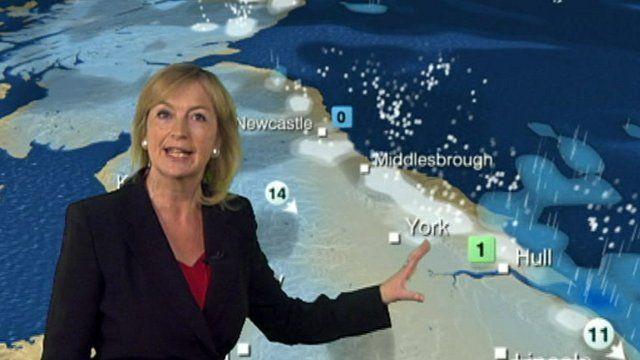 Carol Kirkwood with weather map