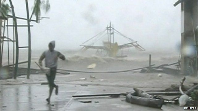 Man running from debris