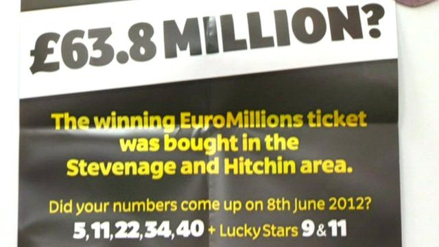 Poster asking the winner to come forward, advertising the winning numbers 5, 11, 22, 34, 40.