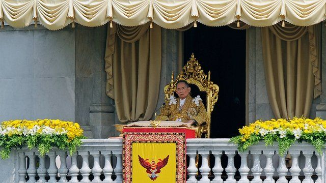 Thai King Bhumibol Adulyadej appears before crowds in Bangkok