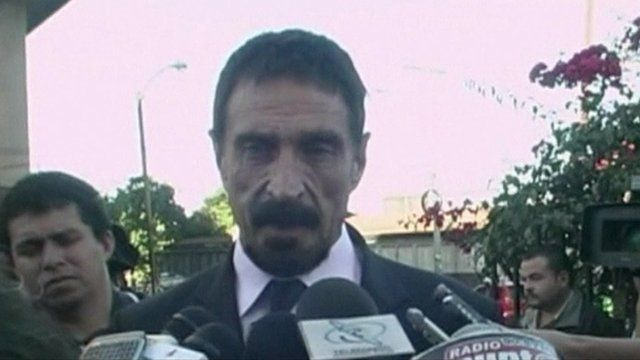 John McAfee talking to journalists