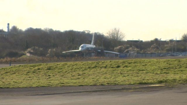 A Concorde aircraft parked up in a corner at Filton Airfield in Bristol