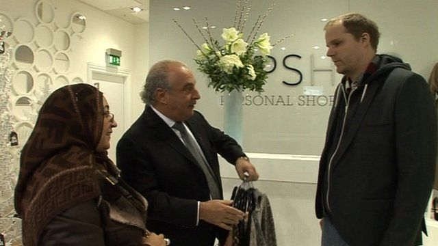 Sir Philip Green with customers in Topshop