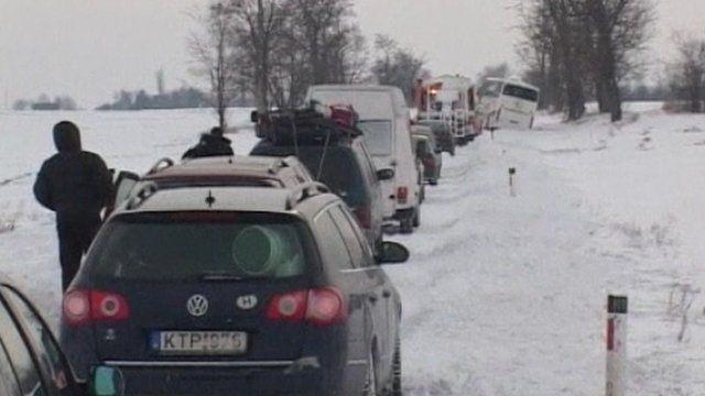 Queue of cars in snow