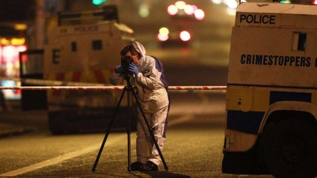 Police forensics officer at scene of petrol bomb attack