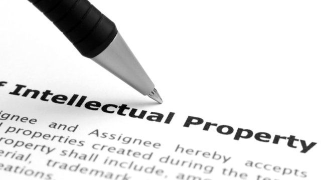 A sheet of paper reading 'Intellectual Property'