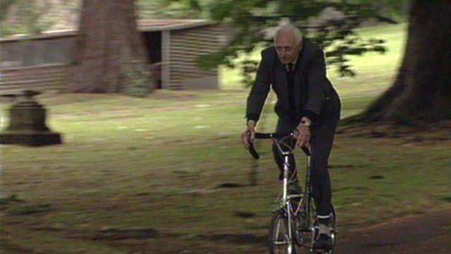 Dr Moulton riding one of his bikes