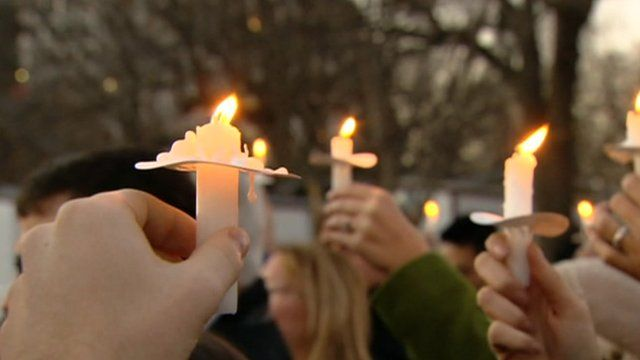 Gun control advocates hold candles outside the White House in Washington