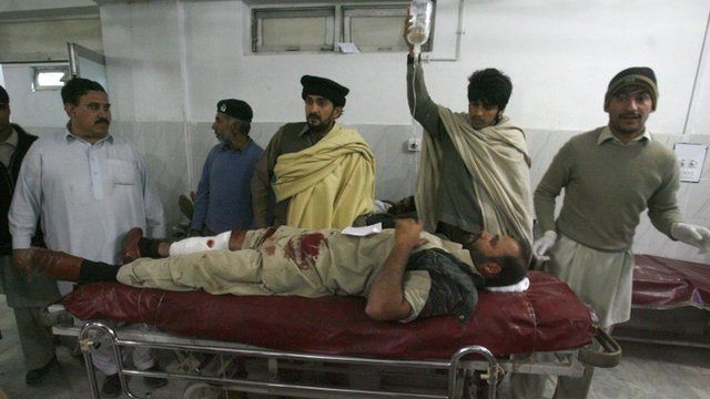 Man injured during rocket attack in Pakistan receives medical treatment at a hospital