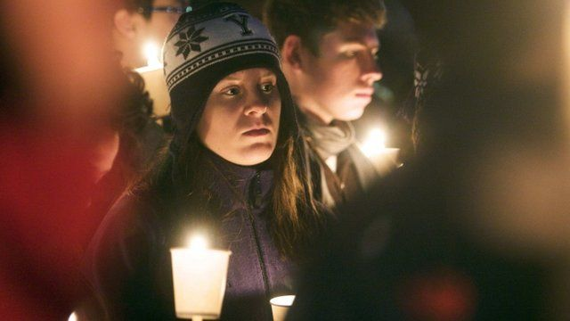 People gathered in a candlelight vigil for the dead in Newtown, Connecticut