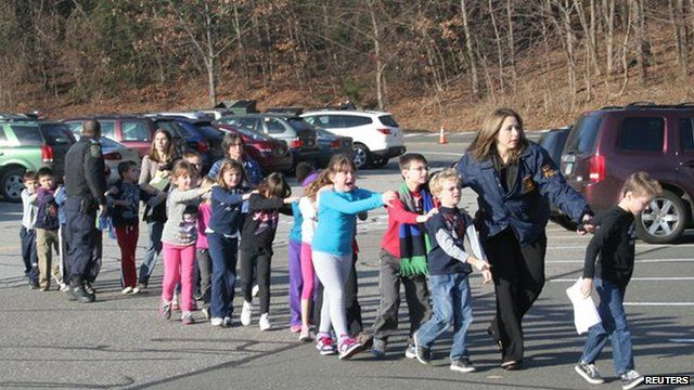 Children escape from Sandy Hook School after shooting