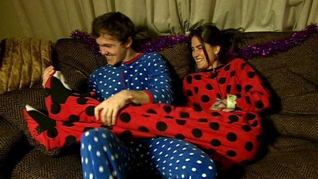 "Couple wearing ""onesies"""