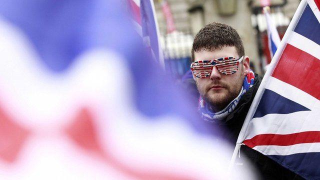 Flag protestor at Belfast City Hall