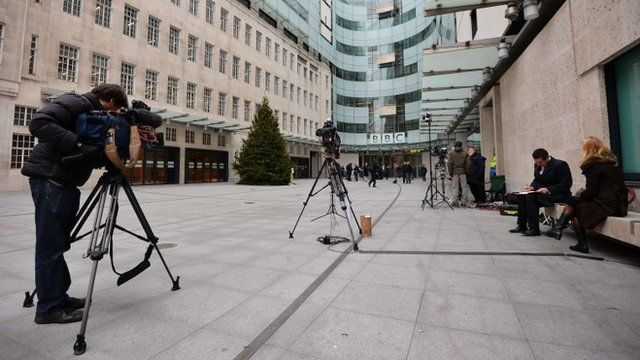 News crews gather outside BBC Broadcasting House in London
