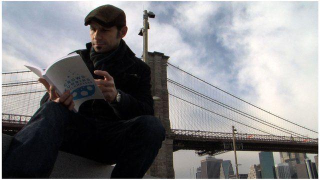 John Trigonis reading a book