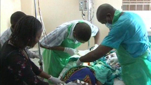 Doctors working on patient