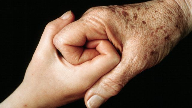 Young person and Old old holding hand