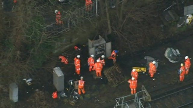 Engineers at Preston Park, Brighton, fixing the problem caused by a cable fire