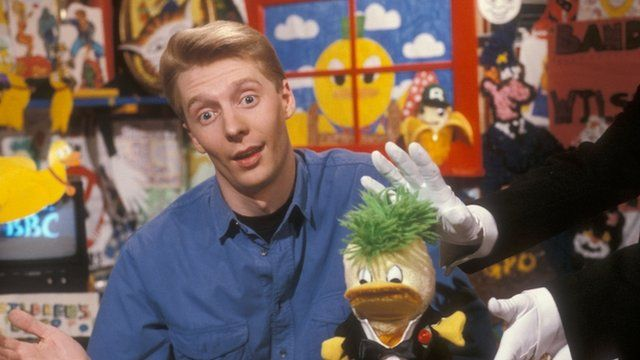 Andy Crane in the broom cupboard with Edd the Duck in 1990