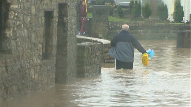 Man in floodwater