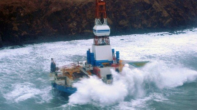 Shell oil rig Kulluk seen grounded off the coast of an Alaskan island