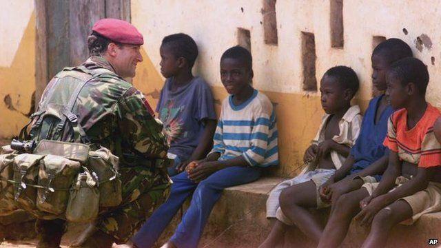British para near Lungi airport speaks to children in 2000