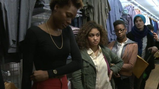 Job seekers queuing for an interview in a clothing shop