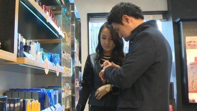 Korean man tries cosmetics in shop