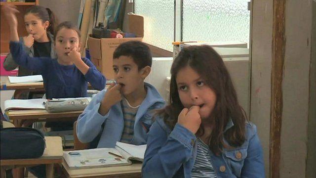 Children at school learning silbo gomero