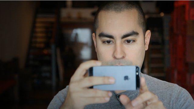 Cesar Kuriyama filming with an iPhone