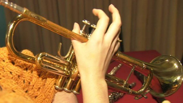 Playing a trumpet