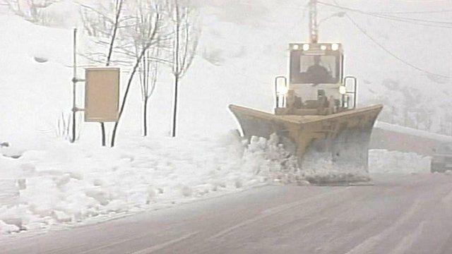 A snow plough shovels snow in Lebanon